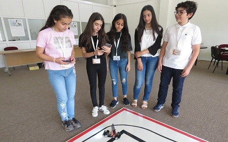 A team demonstrates their invention at Salahaddin University on Monday. Photos: AC Robinson/Rudaw