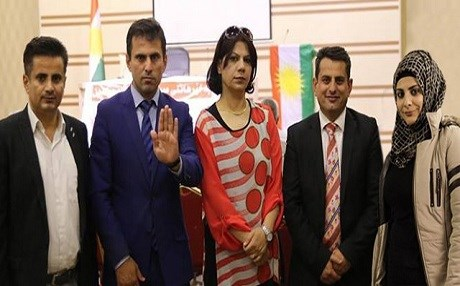 Zana Aziz Karim (second-left) is shown with his two brothers, a sister, and sister-in-law in Erbil. Photo: Rudaw