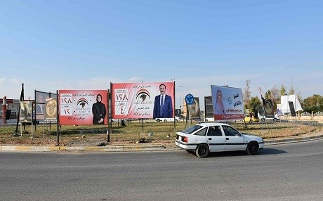 A picture taken on April 14, 2018 in Kirkuk shows campaign billboards for candidates in the upcoming parliamentary elections. Photo: Marwan Ibrahim  | AFP