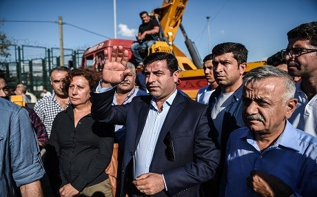 In this file photograph taken on September 4, 2016, Pro-Kurdish Peoples' Democratic Party (HDP) leader Selahattin Demirtas waves during a peace rally in Istanbul, against the war in Syria. Photo: Ozan Kose | AFP