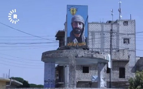 The image of YPG hero Abu Leyla who died in the war against ISIS in Manbij looks out over the city. Photo: Rudaw