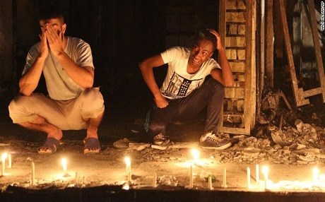Mourners light candles at the site of the deadly bombing in Karrada, Baghdad, July 2016. Photo: Hadi Mizban/AP