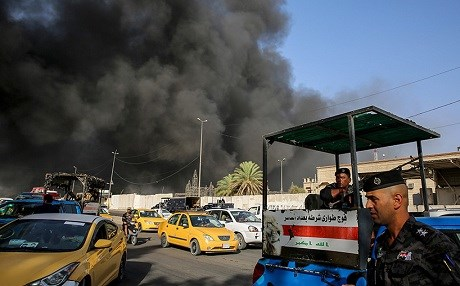 Smoke billows from a fire at a warehouse of the Iraqi election commission in Baghdad on Sunday. Photo: Sabah Arar/AFP