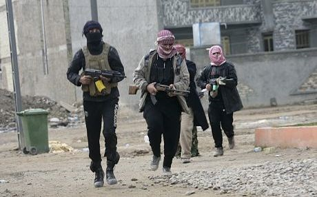 ISIS militants patrolling streets of Mosul shortly after seizing control of the city in summer 2014. File photo: AFP
