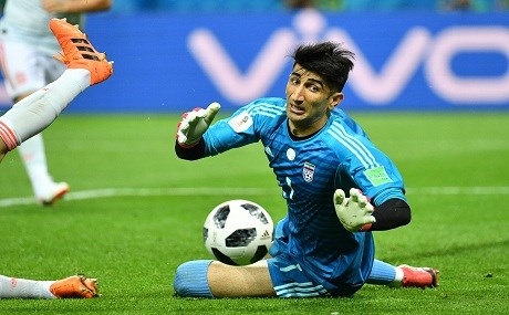 Iran's goalkeeper Alireza Beiranvand dives to save the ball during the Russia 2018 World Cup Group B football match between Iran and Spain at the Kazan Arena in Kazan on June 20, 2018. Photo: Saeed Khan / AFP