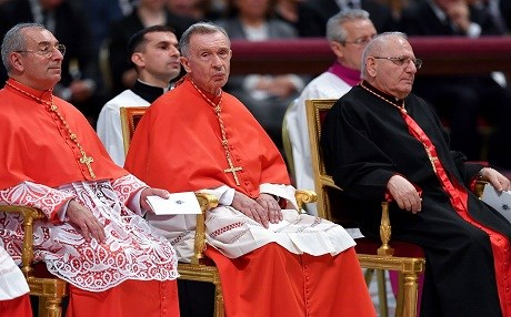 From left: Angelo De Donatis General Vicar of Rome, Luis Francisco Ladaria Ferrer prefect of the Congregation for the Doctrine of the Faith and Louis Raphael I Sako patriarch of Babylon of the Chaldeans attend the consistory where Pope Francis creates 14 new cardinals on June 28, 2018 at St Peter's basilica at the Vatican. Photo: Andreas Solaro/AFP