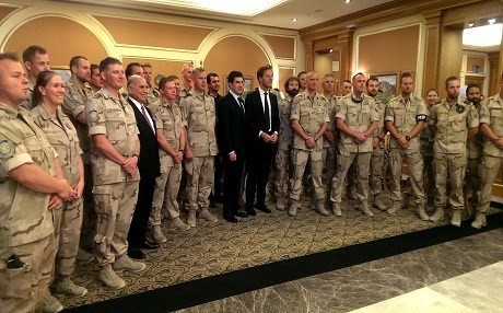 Dutch Prime Minister Mark Rutte and KRG PM Nechirvan Barzani pose with Dutch troops at Erbil airport in 2016. Photo Judit Neurink/Rudaw