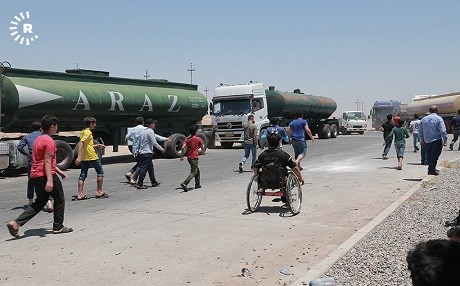 People in Kalak, Kurdistan Region, halt traffic on July 7, 2018, to protest electricity shortages. Photo: Mohammed Shwani | AFP