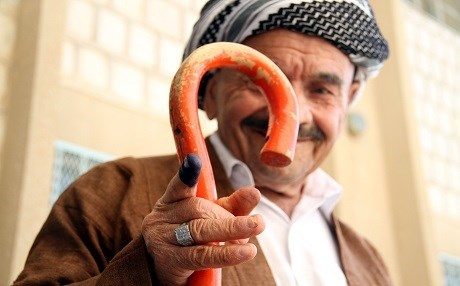 A man shows his ink-stained finger to indicate he voted after the Kurdistan Region's parliamentary election in 2013. Photo: Sartip Othman | Rudaw