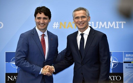 Canada Prime Minister Justin Trudeau (left) is welcomed by NATO Secretary General Jens Stoltenberg as he arrives at NATO headquarters in Brussels, on July 11, 2018. Photo: Eric Lalmand | AFP