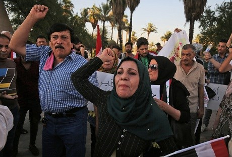 Iraqis in Baghdad protest against poor services and high unemployment on Friday. Photo: Ahmad al-Rubaye/AFP
