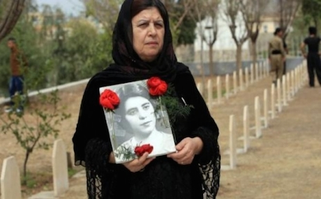 A Halabja woman visits the grave of her sister killed in the chemical gas attack of March 1988. Photo: AP