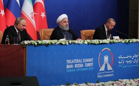 An image on September 7, 2018, shows Iranian President Hassan Rouhani (center) during a press conference with Turkish President Recep Tayyip Erodgan (right) and Russian President Vladimir Putin in Tehran after their trilateral meeting as Iran hosted a summit on the Syrian conflict. Photo: AFP / Iranian President's Office