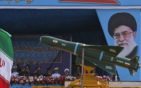 The Iranian military parades missiles past a portrait of Ayatollah Ali Khamenei during a ceremony for the country's annual army day in April in Tehran. Photo: Atta Kenare/AFP