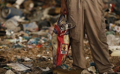 A man collects rubbish from a makeshift trash dump in Raniya, Sulaimani Province. File photo: Rudaw