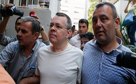 US pastor Andrew Brunson is escorted by Turkish authorities in Izmir, Turkey, during court proceedings in August 2018. Photo: AA
