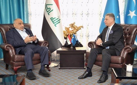 Iraqi PM designate Adil Abdul-Mahdi (left) is welcomed to Turkemen Front headquarters in Baghdad by party head Arshad Salihi on October 12, 2018. Photo: Abdul-Mahdi FB