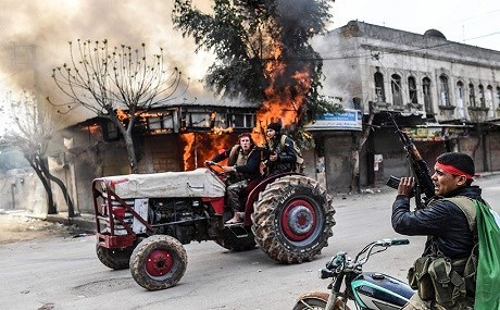 Turkish backed Syrian proxies who seized Afrin city center photographed looting businesses and belongings. File photo: AFP