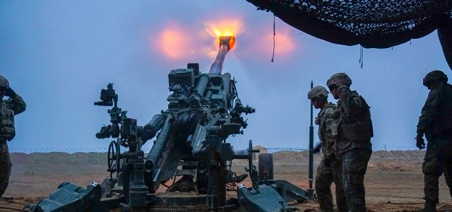 US Army troopers fire a M777 Howitzer at Firebase Saham on December 2, 2018 on Iraq's border with Syria where US and Iraqi forces secure the border from ISIS militants fleeing the battlefield in Syria. Photo: US Army/Capt. Jason Welch