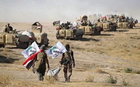 Members of the Hashd al-Shaabi advance on Tal Afar during the war against ISIS in August 2017. File photo: Ahmad al-Rubaye/AFP