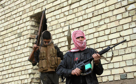Gunmen in Falluja patrol the streets during clashes with Iraqi troops in January. Photo: AP