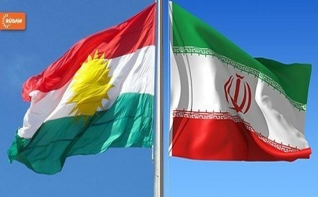 The Flag of Kurdistan flies next to the Flag of the Islamic Republic of Iran. File photo: Rudaw