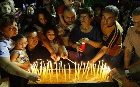 Armenians hold a candle light ceremony in Lebanon. Photo: AFP