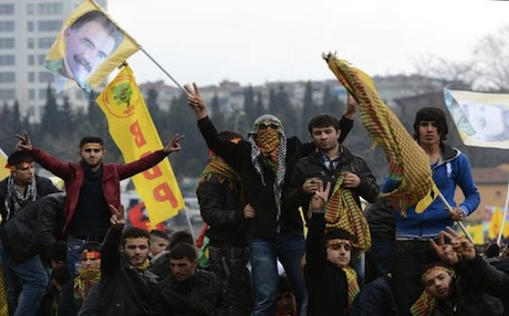 Kurds in Diyarbakir city wave pictures of jailed PKK leader Abdullah Ocalan a few days before his peace declaration on March 21. Photo: AP