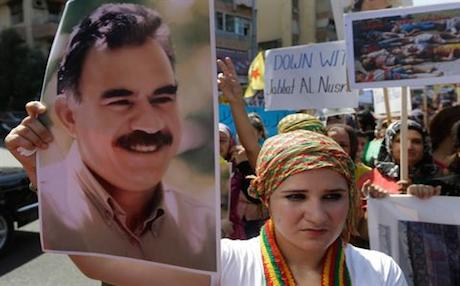 A supporter holds up a picture of PKK leader Abdullah Ocalan. Photo: AP