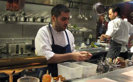 Amedi at work in the kitchen of his London restaurant. Photo by author.