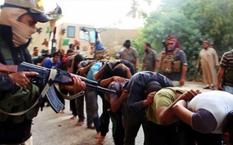 A photo from a jihadi website shows ISIS capturing Iraqi soldiers. AP file photo.